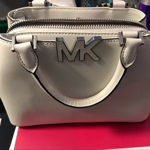 Michael Kors white purse.In Mint condition used 2x